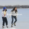 Arden Kelly (left) and Zeny Collier of Brookline, Mass., skate on Lake Champlain near their seasonal home on Lake Shore Road in Chazy, where they are spending February break. According to the National Weather Service, today will be mostly cloudy, with rain or snow likely this morning and highs around 40.<br><br>()