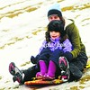 Caely Charland (front) and her mom, Kelly, blaze a trail through wet snow Thursday on Fox Hill at South Platt Park in Plattsburgh. The weather forecast for today is a 90 percent chance of snow with accumulations up to 4 inches.<br><br>(P-R Photo/Rob Fountain)