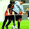 West Chazy Pirates team member Aidan Vogl (left) battles for position against Plattsburgh City Team Falb player Rayane Yahiaoui during a Youth Soccer U12 game at the Crete Memorial Civic Center Wednesday. The winter league is hosted by the City of Plattsburgh Recreation Department.<br><br>(P-R Photo/Rob Fountain)
