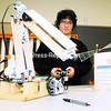 Plattsburgh High School student Justin Collins demonstrates the robotic arm he made from scratch Wednesday as part of the Science Olympiad team that scored first and second place at the regional Olympiad.<br><br>(P-R Photo/Rob Fountain)