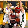 After grabbing a rebound, Willsboro's Karin Buck (middle) finds herself hounded by Elizabethtown-Lewis players Shonna Brooks (left) and Clare Harwood (right) during a Section VII Class D girls' basketball semifinal game at AuSable Valley Central School Tuesday. Elizabethtown-Lewis won, 72-28. Bonus photos will be available midday at www.pressrepublicanphotos.com.<br><br>(P-R Photo/Rob Fountain)