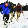 Fred Hooper (from left), John Morris and Scott Morris, all on skates, clear snow from a small pond off Old Turnpike Road near Elizabethtown prior to an impromptu hockey game.<br><br>(Staff Photo/Alvin Reiner)