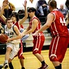 Elizabethtown-Lewis guard Hunter Mowery drives against Moriah's Jessup Calkins and Tim Breeyear with Ryan Shpur (44) waiting in the paint during a boys' basketball game Tuesday. The Vikings won, 50-45.<br><br>(Staff Photo/Alvin Reiner)