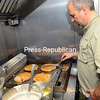 Jim McCartney cooks up a variety of pancakes during Shrove Tuesday at the Trinity Episcopal Church in Plattsburgh. Shrove Tuesday, also known as Pancake Tuesday and Fat Tuesday, is the day preceding Ash Wednesday, the first day of Lent.<br><br>(P-R Photo/Rob Fountain)