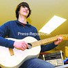 Plattsburgh High School student Walker Gosrich plays his guitar he made from scratch Wednesday.  Collins was part of the Science Olympiad Team that scored first and second place at the Regional Tournament for the fourth year in a row.  They will also be competing at the State Tournament in March.<br><br>(P-R Photo/Rob Fountain)