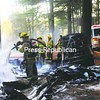A fire gutted a woodworking shed, trailer and car Monday at 282 Giddings Road in Chesterfield. All three were damaged beyond repair. <br><br>(Staff Photo/Kelli Catana)