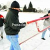 Dave Champagne (from left), Mike Rock and Kevin Randall set up hockey nets on the pond recently at the American Legion Post 1619 in West Plattsburgh. The group is preparing for Winterfest, which runs from Feb. 3 to 5. <br><br>(P-R Photo/Rob Fountain)
