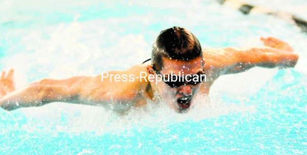 AuSable Valley's Ben Ford earns a win in the 200-yard individual medley during a boys' swim meet against Plattsburgh High Tuesday. The Hornets won the meet.<br><br>(P-R Photo/Rob Fountain)