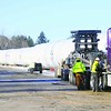 Wind-turbine tower sections are loaded onto trucks at the Canadian Pacific rail yard. Early this week, the 248 tower sections will be moved from the rail yard on South Junction Road in Plattsburgh to their final destination in Pennsylvania. The trucks are each about 180 feet long and weigh about 244,000 pounds.<br><br>(Staff Photo/Kelli Catana)