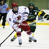 Plattsburgh State's Alex Brenton (19) skates down the ice with the puck while being pursued by Skidmore's Alex Essaris during a men's hockey game at Stafford Ice Arena Saturday. The Cardinals won, 6-3.<br><br>(P-R Photo/Gabe Dickens)