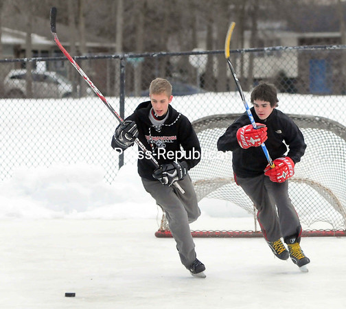 "With a crisp chill in the air, Haydin Fountain (left) and Austin Hackett battle for the puck Thursday at Peter Blumette Park in Plattsburgh. The two were playing pick-up hockey with friends. ""We come out and play almost every day,"" Fountain said.<br><br>(P-R Photo/Rob Fountain)"