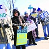 Outside Congressman Bill Owens's Plattsburgh office, Bill Cowan of Plattsburgh (from left), Rita FitzGerald of Whallonsburg, Mona White of Willsboro, Bill Provost of Plattsburgh, Jack Andrus of Plattsburgh and Dawn-Marie Turner of Plattsburgh protest the U.S. Supreme Court's decision to consider corporations as people.<br><br>(Staff Photo/Kelli Catana)