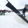 "Inmates from Adirondack Correctional Facility in Ray Brook and community volunteers cut from Pontiac Bay for the Saranac Lake Winter Carnval Ice Palace. Although warm weather had threatened the project, construction is on track. The carnival runs Feb. 3 to 12. This year's theme is ""Space Alien Invasion.""<br><br>(P-R Photo/Jack LaDuke)"