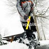 Jason Lee clears his driveway of newly fallen snow Thursday on Erin Avenue in the City of Plattsburgh.<br><br>(P-R Photo/Rob Fountain)