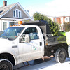 City of Plattsburgh Public Works maintenance worker Peter Dame picks up Christmas trees on North Catherine Street. Pickup is provided to those who get City Refuse Service. While free now, after Jan. 13, $20 will charged per tree.<br><br>(Staff Photo/Kelli Catana)