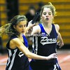 Peru's Cheyanne Dobozy takes the baton from teammate Taylor Durocher during the 3,200 relay in a CVAC indoor track and field meet Saturday at the Plattsburgh State Field House. Durocher and Dobozy, along with Sonja Brown and Rebecca Romanowicz, won the event.<br><br>(P-R Photo/Rob Fountain)