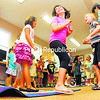 """Children perform folk dances from other countries during the Town of Chazy Recreation Department's Summer Reading Camp at the Chazy Public Library. The three-day camp, promoting the idea that """"Reading is Fun,"""" focused on Teaching children about other countries. On Thursday, the last day of the program, they performed """"Tuck Me in Tales,"""" dancing, reading poems they wrote and putting on short plays. The camp was part of the national Dream Big Read! program.<br><br>(P-R Photo/Rob Fountain)"""