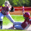 Saranac Lake's Chelsea LaFountain (right) slides in safely on a steal of second, beating the throw to Beekmantown's Sam Swiesz during a CVAC softball game Friday at Beekmantown Rec Park. The Red Storm won, 10-3.<br><br>(P-R Photo/Gabe Dickens)