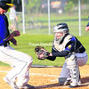 Clinton County Mariners catcher C.J. Worley looks to apply the tag to Essex's Teddy Andrews during Wednesday's American Legion baseball game at Lefty Wilson Field. The Mariners dropped the game, 7-4.<br><br>(P-R Photo/Rob Fountain)