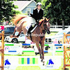 Emily Kinch, riding Landora 11, clears a jump Thursday at the Lake Placid Horse Show during the Deeridge Farms A/O Jumper Event. Kinch placed seventh.<br><br>(P-R Photo/Jack LaDuke)