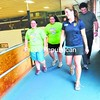 Izzi Saucier, 16, (left) and her sister, Gabrielle Saucier, 17, walk the track at the Plattsburgh City Gym and Recreation Center with Olympians Erin Hamlin and Steve Langton. Hamlin and Langton talked to teens in the Biggest Loser program about living as an athlete, setting goals and motivating themselves.<br><br>(Staff Photo/Kelli Catana)