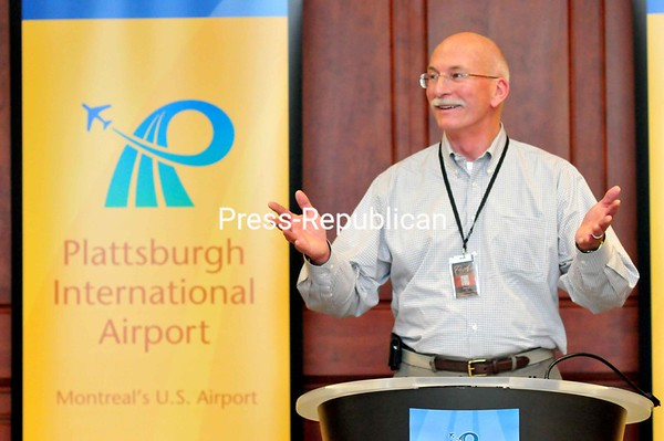 PenAir Chief Operating Officer Dave Hall announces that PenAir is scheduled to start service between Plattsburgh and Logan International Airport in Boston on June 15. <br><br>(Staff Photo/Kelli Catana)