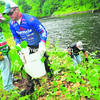 """Zach Caudle of Shreveport, La.; Dave Wolack of Wake Forrest, N.C.; and Andrew Upshaw of Hemphill, Texas (from left), clear      brush at Waterhouse Street Park in Plattsburgh. About 20 FLW anglers helped clean the park this week. """"We make it more about the community,"""" Caudle said.<br><br>(Staff Photo/Kelli Catana)"""
