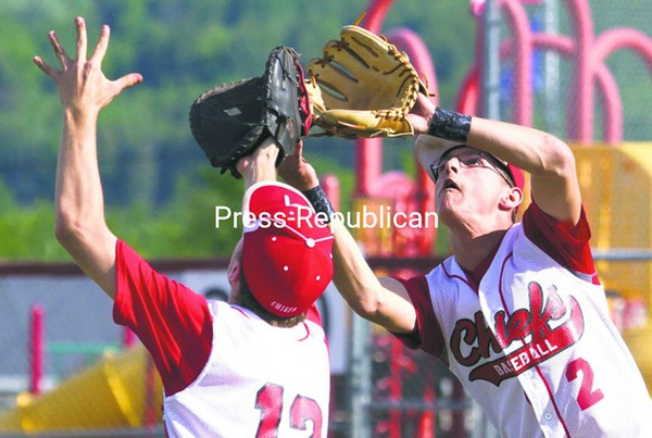 Saranac's Andrew Petro (12) and Jordan Gillespie (2) both converge on a fly ball during a CVAC baseball game against Plattsburgh High Tuesday in Saranac. The Chiefs won, 2-0.<br><br>(P-R Photo/Gabe Dickens)