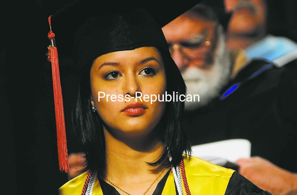 Student speaker Cindy Arellano listens during Plattsburgh State's commencement ceremony at the Field House Saturday. More than 1,000 students were eligible to receive their diplomas. Arellano is a business and marketing major from Lima, Peru.<br><br>(P-R Photo/Rob Fountain)