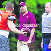 New Plattsburgh North Stars head coach Scott Aguglia (center) talks to some of his players at practice Thursday. The North Stars open their season tonight at 6 p.m. at Plattsburgh High School.<br><br>(P-R Photo/Rob Fountain)