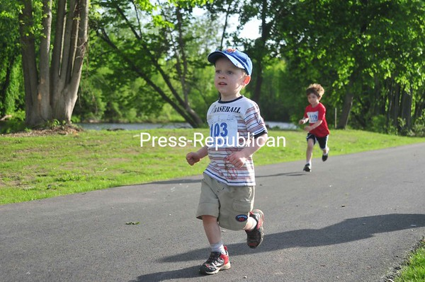 Brennan Peters (left) and Cole Purcell kick off the opening of the Saranac River Trail with a fun run hosted by the Town of Plattsburgh Recreation Department. <br><br>(Staff Photo/Kelli Catana)