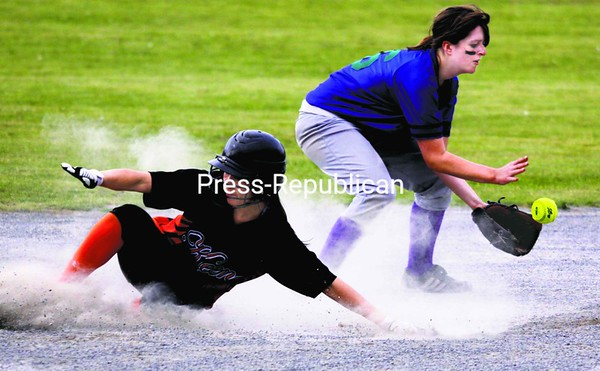 Keene's Emma Gothner makes it safely into second as Minerva/Newcomb's Marlena Peter awaits the ball during an MVAC softball game played in Keene   Valley Monday. The Mountaineers won, 7-4. <br><br>(Staff Photo/Alvin Reiner)