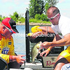 Professional angler Jacob Powroznik (left) helps Plattsburgh's Jason Bezio bag one of his bass Thursday. Powroznik is third in the pro standings after Day 1 of the FLW Tour   event on Lake Champlain.<br><br>(P-R Photo/Rob Fountain)
