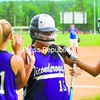 Ticonderoga's Kiley Austin (left) and Jordan McKee (right) congratulate Megan Campney (center) after Campney scored a run in the Sentinels' 11-0 win   over AuSable Valley in CVAC softball in Clintonville Monday.<br><br>(Staff Photo/Ryan Hayner)