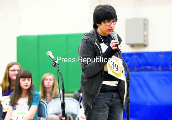 "Nicolas Manfred spelled the word ""quinine"" to win Friday night's Champlain Valley Educational Services Regional Spelling Bee, which was co-sponsored by the Press-Republican. The victory qualifies the Moriah Central School student for the Scripps National Spelling Bee in Washington, D.C. His travel expenses and those of a chaperone will be covered by the newspaper and the North Country Parents group.<br><br>(P-R Photo/Gabe Dickens)"