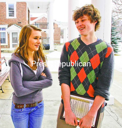 Westport Central School junior Alexander Steele talks to his sister, Moira, outside the Old County Courthouse in Elizabethtown. He was recognized by Essex County lawmakers for saving her from their burning home in February. <br><br>(Staff Photo/Lohr McKinstry)