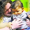Betty Carr plays with her son, Castle, in West Lawn, Pa. Carr was accepted into a 90-day housing program run by Family Promise of Berks County Inc., a nonprofit that works with three dozen area houses of worship to have the churches take in families. The families spend a week in one church before moving on to live temporarily in another one.<br><br>(AP Photo/Reading Eagle, Ben Hast)