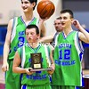 Flanked by teammates Carson Hynes (left) and Eddie LaRow (right), Seton Catholic's Caleb Larson holds the Section VII Class C championship trophy after the Knights defeated Ticonderoga, 56-49, in the title game at the Plattsburgh State Field House Saturday. See story, Page B3. Bonus photos will be available midday Monday at www.pressrepublicanphotos.com.<br><br>(P-R Photo/Gabe Dickens)