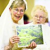Lady Anne Clifford (played by Elle Berger) shows some photographs from her home in North Yorkshire, England, where her family owned vast estates, to guests at Delta Kappa Gamma Society Psi chapter's ninth-annual Tea with Famous Ladies, held recently at Peru Community Church's Fellowship Hall. Clifford, who lived from 1590 to 1676, was an early feminist and an author — she accomplished much during her lifetime.<br><br>(P-R Photo/Gabe Dickens)