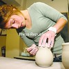 Jillian Post works on trimming the lid for a vessel during open studio in the Jackie Sabourin Clay Studio at North Country Cultural Center for the Arts in Plattsburgh. The studio is available during the week for those wishing to work on their skills in wheel throwing and projects. A punchcard is available for $30 and is good for 10 hours of studio time. Hours are from 4:30 to 6:30 p.m. Wednesday through Friday and noon to 4 p.m. Sunday.<br><br>(P-R Photo/Rob Fountain)