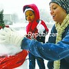 Chantelle Jackson-Gaines helps Adrianna Lee, 3, build a snowman on Cornelia Street in Plattsburgh Thursday.<br><br>(Staff Photo/Kelli Catana)