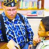 Air Force Veteran Philip Rossignol visits during lunchtime with Jordan Thompson, a fifth-grader at Momot Elementary School.<br><br>(Staff Photo/Kelli Catana)