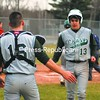 Chazy's Austin Santor (16) congratulates Craig Botten (13) after Botten scored a run during a baseball scrimmage against Saranac Friday at Saranac Central. The Eagles are the defending Section VII Class D champions. Mountain and Valley Athletic Conference baseball begins April 16.<br><br>(Staff Photo/Ryan Hayner)