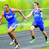 Peru's Alex Barrett (left) takes the baton from teammate Ryan Lawrence in the 400-meter relay during a CVAC track and field meet against Northeastern Clinton Tuesday in Champlain. The Indians won the event, along with Bryce Schnaars and Tyler Clement, and the meet, 85-42.<br><br>(P-R Photo/Rob Fountain)