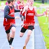 Saranac's Heath Andre takes the baton from teammate Justin Liechty while competing in the 3,200-meter relay during a CVAC boys' track and field meet Tuesday. The Chiefs won the event and the meet, 118-14.<br><br>(P-R Photo/Rob Fountain)