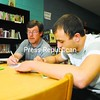 Dan Madden (left) tutors Damian Cox in algebra Wednesday in the Dannemora Free Library, located in the new Village of Dannemora Community Center located on Emmons Street. The village has secured a loan and a grant to purchase the building, which once houses Dannemora Elementary School.<br><br>(P-R Photo/Rob Fountain)