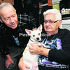 Robert and Theresa Duell hold their dog, Tiny, at their home in Plattsburgh. The couple, who have lived for 30 years at Abenaki Mobile Home Park, have been told they either need to give up the pup or move out.<br><br>(P-R PHOTO/ROB FOUNTAIN)
