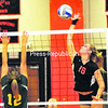 Plattsburgh High's Deanna LaBarge (16) sends a spike back as Northern Adirondack's Olivia Barnaby (12) extends for the block during Wednesday's CVAC volleyball match. The Hornets defeated the Bobcats, 3-0.<br><br>(P-R PHOTO/ROB FOUNTAIN)
