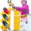 With a slight threat of a shower looming overhead, Plattsburgh Municipal Lighting Department worker Tim Carter performs maintenance on a traffic light at the corner of Bailey Avenue and Beekman Street on Thursday.<br><br>(P-R PHOTO/ROB FOUNTAIN)