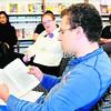 "SUNY Plattsburgh student Charles Lack reads from the book ""Of Mice and Men"" by John Steinbeck during Feinberg Library's recent Banned Book Read-Out. Members of campus and the community were invited to attend the two-hour read-out, which was held in conjunction with the American Library Association's 2012 Banned Book Week. The selections read out loud by participants were from books that have been banned or challenged at some time in history.<br><br>(P-R PHOTO/ROB FOUNTAIN)"